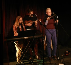 Katie Morton and Hans Landon-Lane are singing a silly song with me